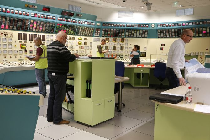 Employees of the French government-owned electricity company EDF work in a simulated control room at the oldest French nuclear power station in Fessenheim during a nuclear accident drill.