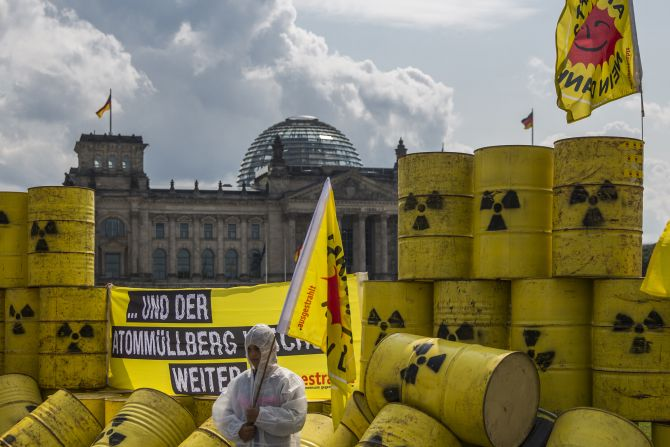 Environmental activists protest with mock nuclear waste barrels outside the Reichstag, the German parliament, in Berlin.