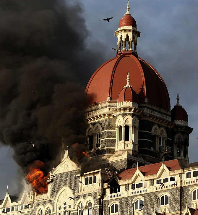 Smoke billows from the Taj Mahal hotel during the 26/11 attacks.
