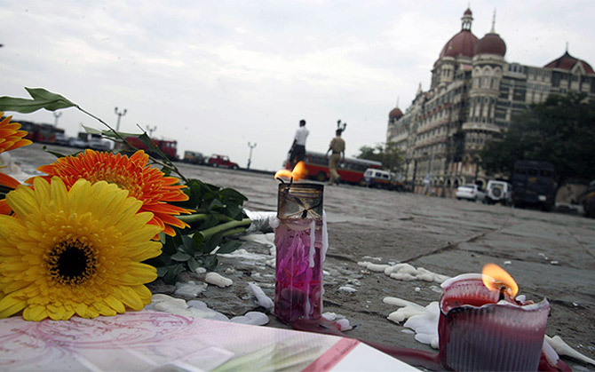 Candles and flowers placed for victims of the Mumbai attacks are seen in front of the Taj Mahal Hotel on November 30, 2008