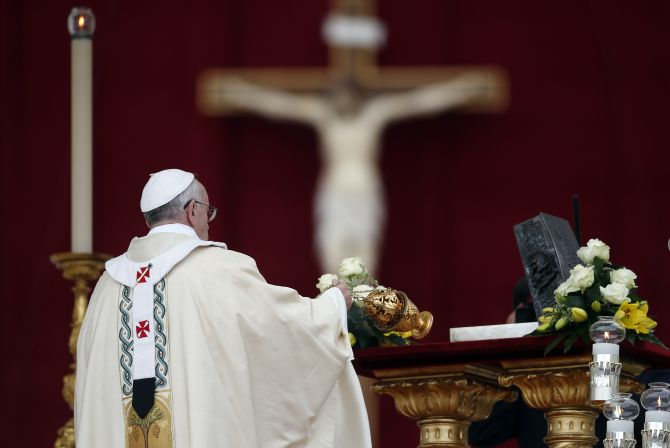 Pope Francis blesses the relics of the Apostle Peter on the altar during a mass at St. Peter's Square at the Vatican
