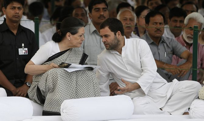 Congress President Sonia Gandhi listens to her son party Vice-President Rahul Gandhi.