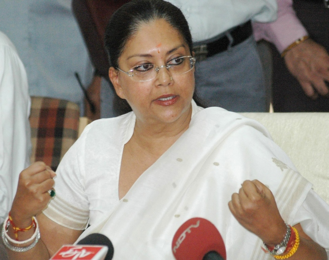 BJP's Rajasthan chief ministerial candidate Vasundhara Raje addresses a news conference in Jaipur