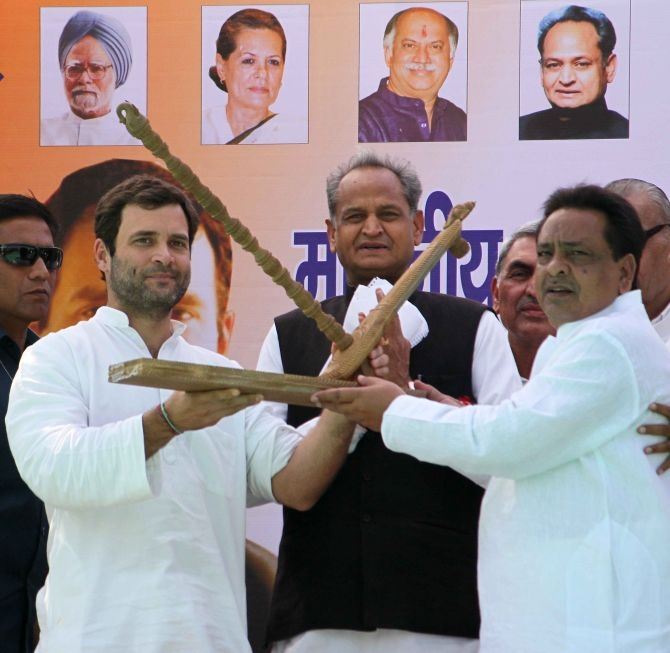 Congress Vice President Rahul Gandhi with Rajasthan Chief Minister Ashok Gehlot at a poll rally in Churu
