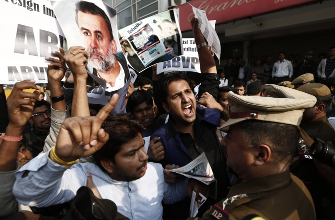 Protesters shout slogans against Tarun Tejpal