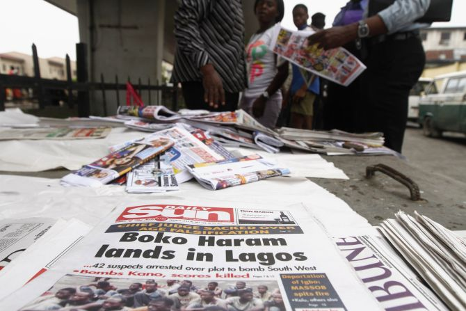 Newspapers are displayed at a vendor's stand along a road in Obalende district in Nigeria's commercial capital Lagos