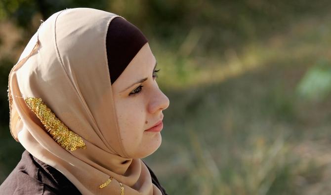An Iraqi female student wearing a veil