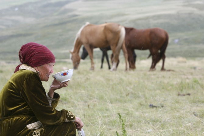 A Kyrgyz woman drinks horse milk at a high altitude summer pasture called Suusamyr, some 170 km south of the Kyrgyz capital Bishkek. Having brought their cattle to the area, local farmers milk their horses to make the local fermented drink kumis, which they sell to supplement their income