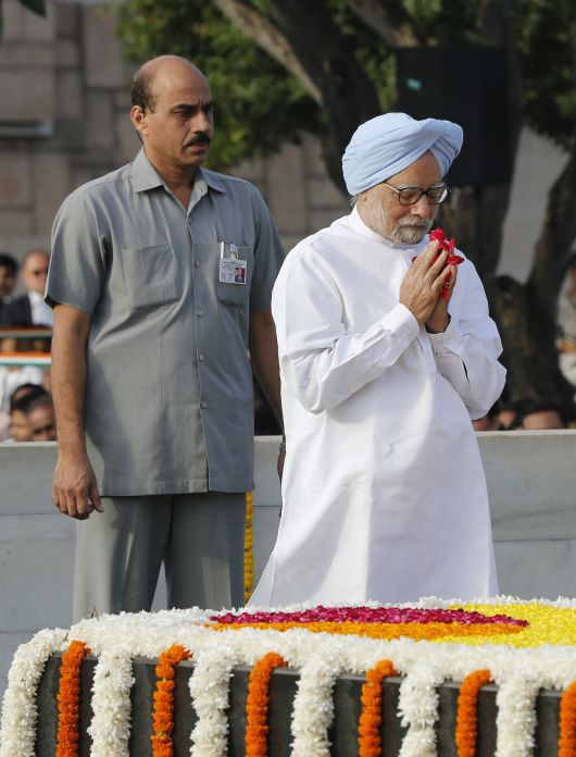 Prime Minister Manmohan Singh pays homage at the Mahatma Gandhi memorial at Rajghat in New Delhi on Wednesday