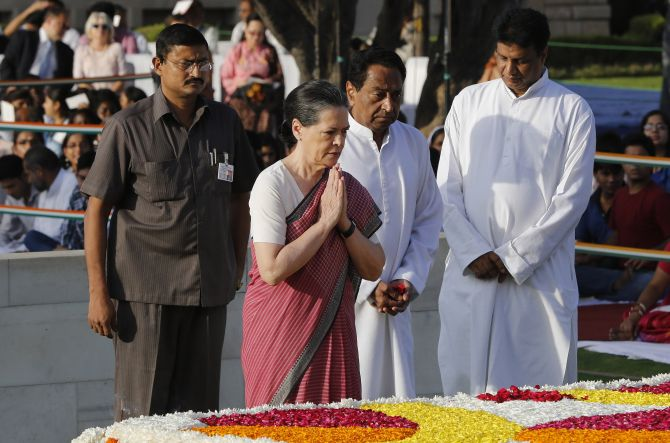 Congress chief Sonia Gandhi and Union minister Kamal Nath pay homage at the Mahatma Gandhi memorial on Friday