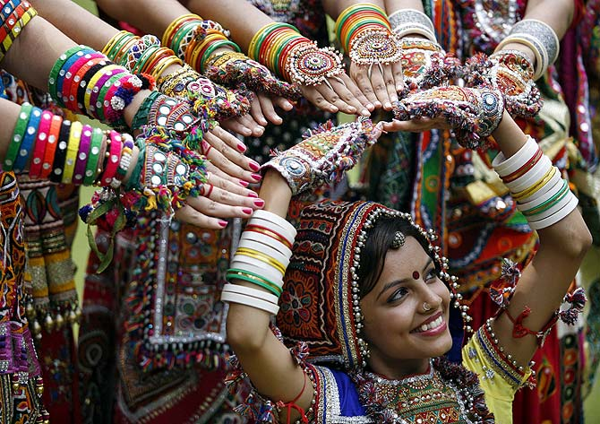 A girl gets ready for the coming Navratri festivities in Ahmedabad.