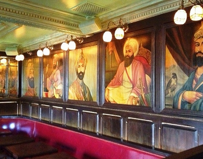The pictures of Sikh gurus have now been removed from the bar