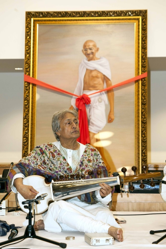 Ustad Amjad Ali Khan performs at the UN on Gandhi's birthday. Seen in the background is a potrait by Mumbai-based artist R D Pareek