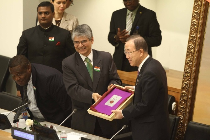 Ambassador Asoke K Mukerji presents a special edition of a book on Gandhi to UN Secretary General Ban Ki-moon