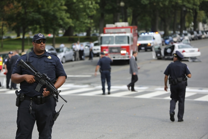 FBI agents patrol the area after gunshots were fired outside the US Capitol building in Washington