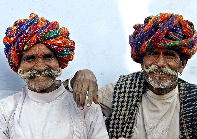 Rajasthani men pose during the Pushkar fair in Rajasthan.