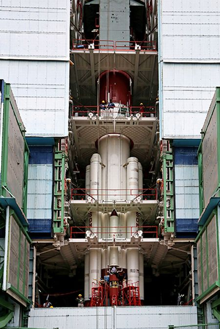 PSLV-C25 first stage being surrounded by strap-ons in the Mobile Service Tower