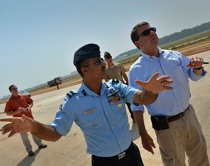Air Commodore Anil Sabharwal of the Indian Air Force gives Dr Ashton B Carter, now the US defence secretary, a tour of a new runway being built at the Hindan Air Force Station near New Delhi, September 18, 2012. Image: Glenn Fawcett/US Department of Defence