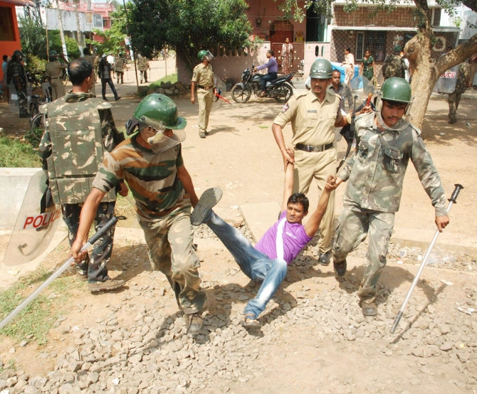 Police crackdown on an anti-Telangana supporter in the Vizianagaram district in Andhra Pradesh