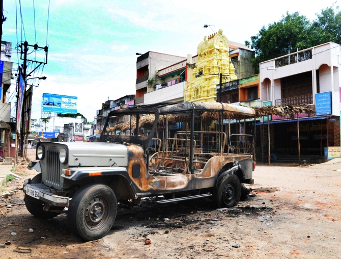United Andhra supporters torch a jeep in Vizianagaram