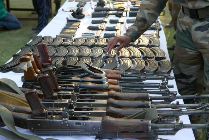 Arms and ammunition recovered during the Keran operation is displayed at the press conference