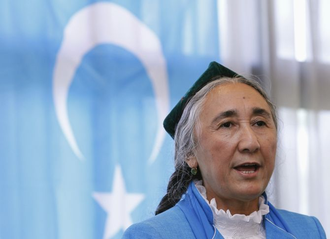 Uighur leader Rebiya Kadeer delivers a speech in front of a East Turkestan flag, in Tokyo.