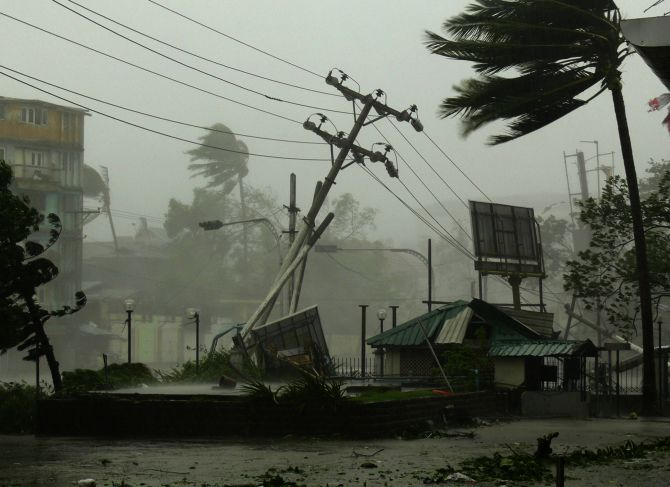 Strong wind and heavy rain blow down electric poles and advertisement signs, and blow away roofs as Cyclone Nargis hits Yangon in this May 3, 2008 photograph.