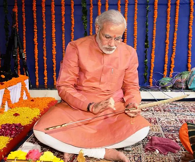 PHOTOS: Modi worships swords and guns