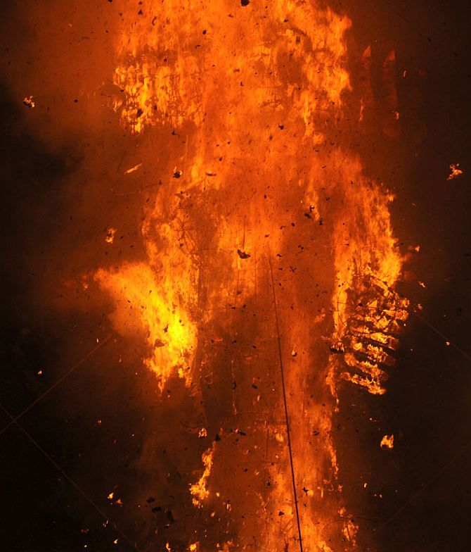 The Ravana effigy in flames at the Dussehra celebrations at Subhash Maidan in New Delhi