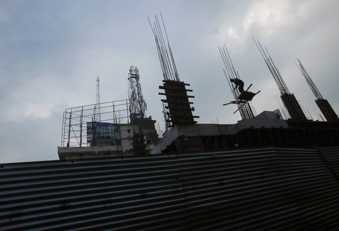 A labourer works at an under-construction shopping mall in Patna