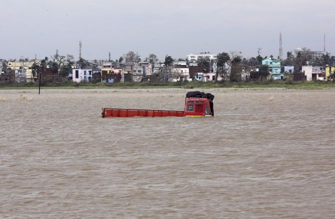 A truck is seen submerged in the water after Cyclone Phailin hit Brahmapur town in Ganjam district