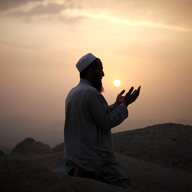 A Muslim pilgrim prays atop Mount Thor in the holy city of Mecca ahead of the annual haj pilgrimage. Mount Thor marks the start of the journey of the Prophet Mohammad and his companion Abu Bakr Al-Sadeeq from Mecca to Medina. It houses Thor cave where Prophet Mohammed is believed hid from the people of Quraish before his Hijra (migration) to Medina.