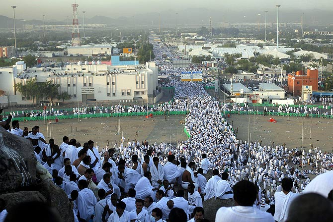 Muslim pilgrims gather atop Mount Mercy on the plains of Arafat during the peak of the annual haj pilgrimage, near the holy city of Mecca