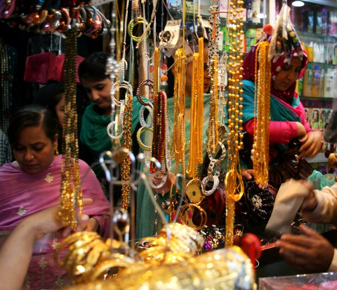 Kashmiri women and girls busy shopping on the eve of Eid-ul-Azha, in a Srinagar market, on Tuesday