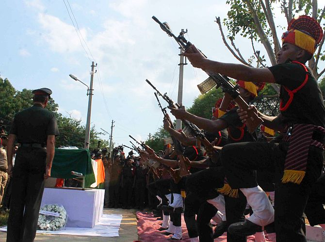 Army personnel give the 21 gun salute to martyred Lance Naik Mohd Firoz Khan in Hyderabad on Thursday