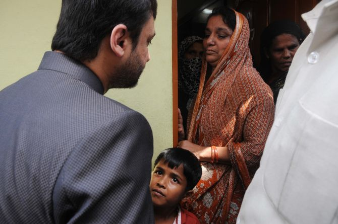 MIM leader Akbaruddin Owaisi consoling Firoz Khan's grieving family in Hyderabad on Thursday