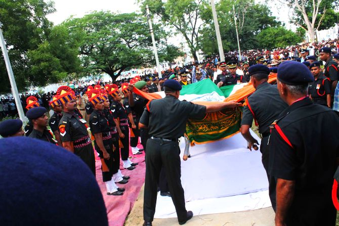 Army personnel draping slain Lance Naik's body with the tricolour ahead of the 21 gun salute