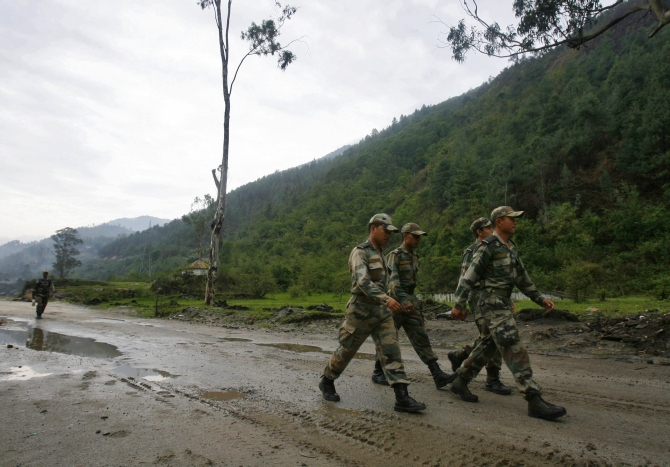 Indian soldiers on the Tezpur-Tawang highway, which runs close to the Chinese border, in Arunachal Pradesh.