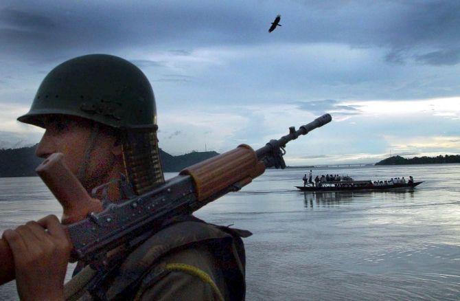 A paramilitary trooper on the banks of the Brahmaputra on the outskirts of Guwahati.