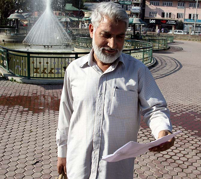 Abdul Rahman Wani takes a look at the pictures of politicians in Pahalgam