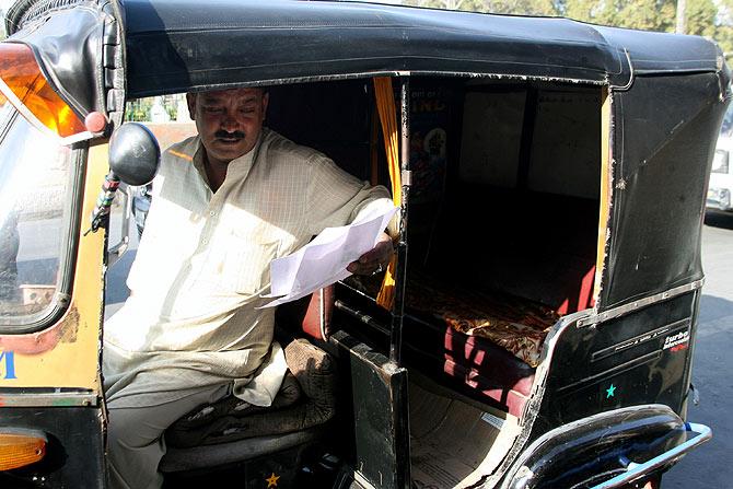 Auto driver Mushtaq Ahmad in Srinagar