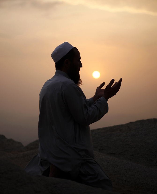 A Muslim pilgrim prays atop Mount Thor in the holy city of Mecca