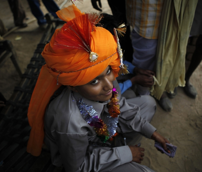 Mahesh, 14, gets ready for his marriage in a village ne