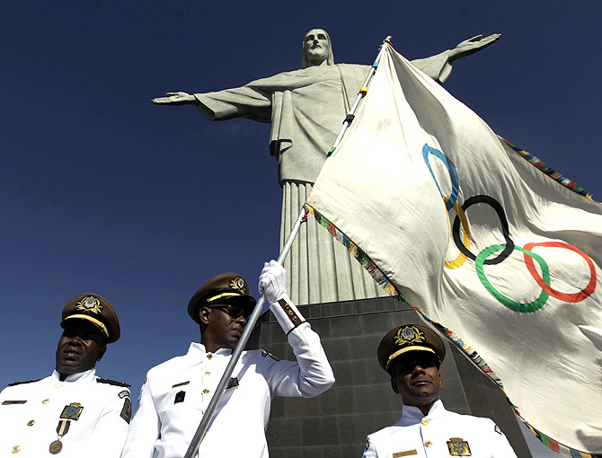 The Olympic flag at the Christ the Redeemer statue in Rio de Janeiro