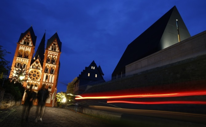 A car drives past the residence of Bishop Franz-Peter Tebartz-van Elst next to Limburg Cathedral in Limburg