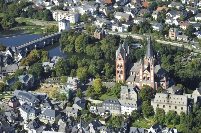 An aerial view shows Limburg cathedral (right) and to the left the construction site for the ensemble of the bishop of Limburg's residence along the river Lahn