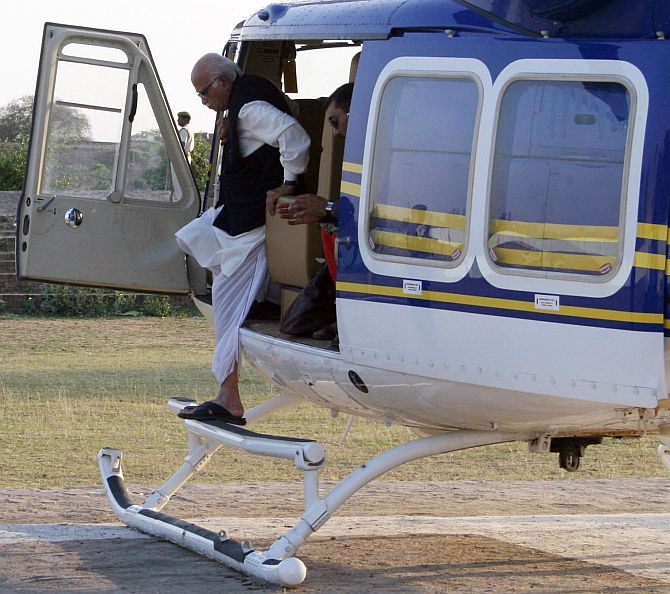 File photo of Bharatiya Janata Party leader L K Advani stepping down from a helicopter during an election campaign rally