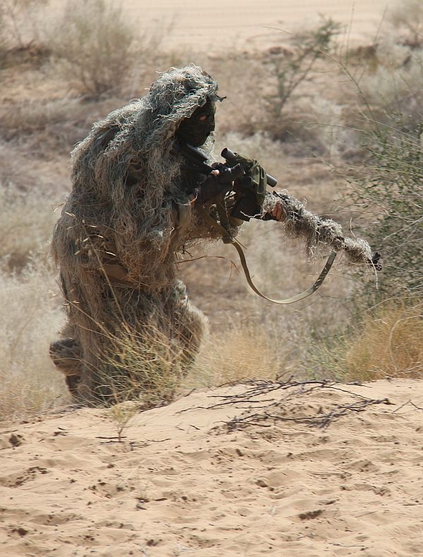 An Indian Army Special Forces soldier takes up a position during a drill