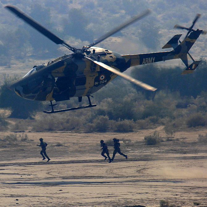 A Dhruv transport helicopter of the Indian Army takes off after inserting teams on the ground