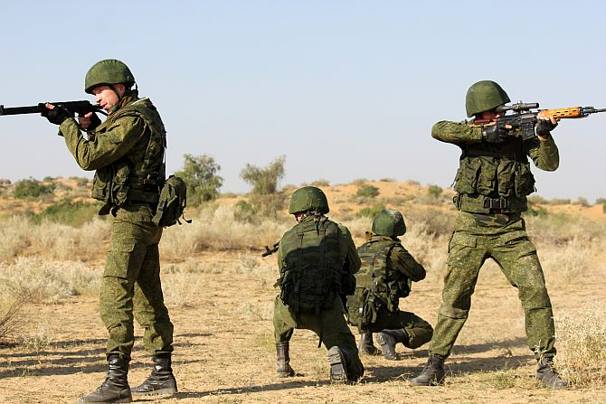 Russian troops take positions during a drill